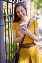 Stylish attractive young woman using a mobile