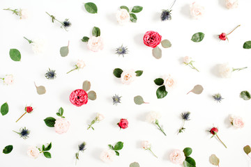 Flower pattern made of red and beige roses, green leaves, branches on white background. Flat lay, top view. Valentine's background. Pattern of flowers. Floral texture.