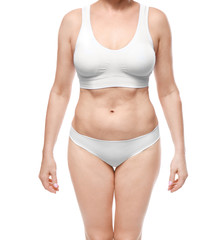 Mature woman in underwear on white background. Weight loss concept