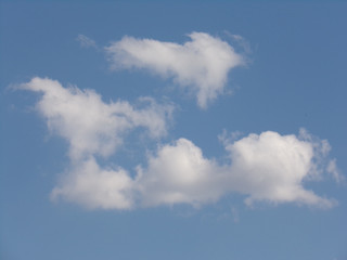 Blue sky with clouds with place for your text.Clouds with a beautiful format, making the sky into a work of art.