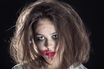 pretty fun crazy girl with fluffy hair and smeared cosmetics on black background