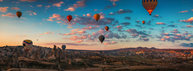 Sunrise and flying hot air balloons over the valley Cappadocia, Turkey.