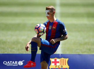 FC Barcelona's newly signed soccer player Lucas Digne plays with a ball during his presentation at Camp Nou stadium in Barcelona