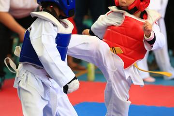 Taekwondo athletes fighting on stage