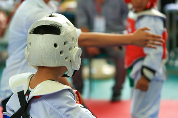 Kids fighting on stage during Taekwondo contest
