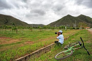 Young boy taking photo of fruit garden