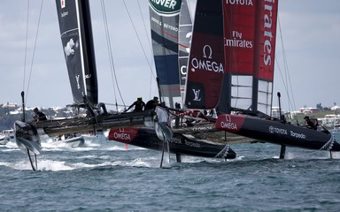 AC45F racing sailboats Emirates Team New Zealand (R) and SoftBank Team Japan cross tacks during race 2 of the America's Cup World Series sailing competition on the Great Sound in Hamilton