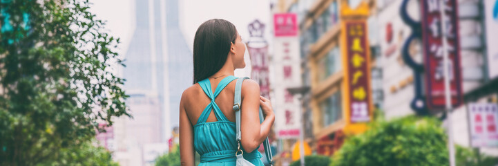Asia city travel lifestyle banner. Tourist woman walking on Nanjing Road shopping street, Shanghai city, China, . Asian girl on urban adventure, famous chinese attraction landmark.