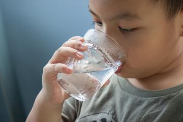 Children drink cold water