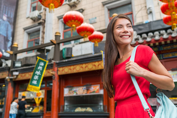 chinatown city lifestyle young Asian woman walking in chinese urban street on china travel. Asia summer travel destination. Girl tourist traveling in Beijing.