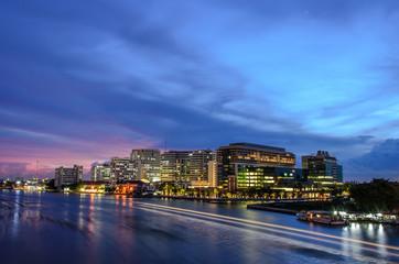 Siriraj hospital, contemporary building across th chao phraya river at twilight, Bangkok, Thailand