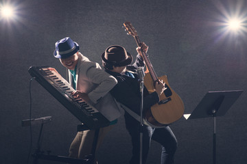 duo musician feeling happy,Keyboard player with guitar player