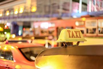 Closeup to taxi sign on the street of Bangkok, Thailand.