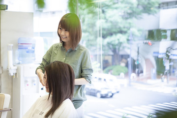 Hairdressers are talking with customers with a smile