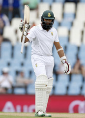 South Africa's Amla raises his bat as he celebrates his half century during the fourth cricket test match against England in Centurion