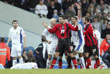 Jermaine Beckford (2nd R) - Leeds United reacts angrily to a challenge made by Adam Virgo (C) - Brighton & Hove Albion