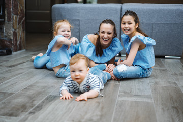 Mom, two daughters and a little son on the floor