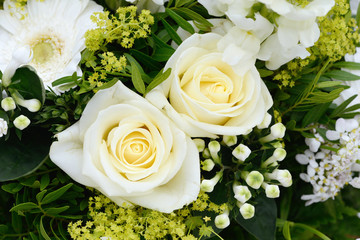 bunch of flowers with white roses