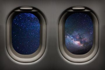 Milky way galaxy viewed from inside an airplane windows in-flight