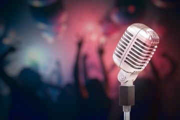3D rendered illustration of silver retro microphone. Dancing people in background.