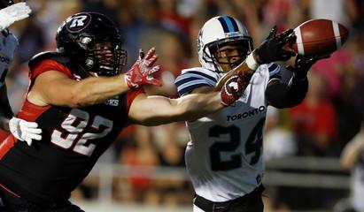 Argonauts' Jefferson intercepts a pass intended for Redblacks' Evans during their CFL football game in Ottawa