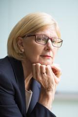 Closeup Portrait of Serious Senior Business Lady