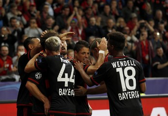 Bayer Leverkusen's Hernandez celebrates with team mates after scoring the third goal against BATE Borisov during their Champions League group E soccer match in Leverkusen