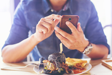 man capturing food picture before breakfast by smartphone