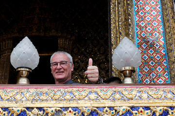 Leicester City soccer club's manager Claudio Ranieri visits the Emerald Buddha temple in Bangkok