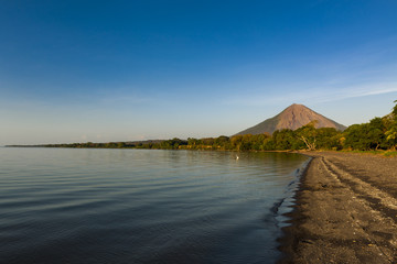 View of a beach at sunset in the Ometepe Island, with the Concepcion Volcano on the background in Nicaragua, Central America