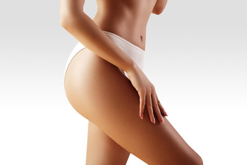 Spa, wellness. Healthy slim body. Beautiful sexy hips. Fitness or plastic surgery. Perfect buttocks without cellulite