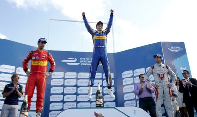 Sebastien Buemi of Renault e.Dams celebrates his win with Lucas Di Grassi of ABT Schaeffler Audi Sport and Jerome D'Ambrosio of Dragon Racing  after winning the race of the E Championship in Punta del Este