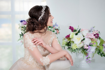 Portrait of a beautiful girl in a wedding dress. Bride with beautiful decoration in her hair