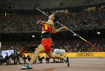 Lyu of China competes in the women's javelin throw qualification at 15th IAAF World Championships in Beijing