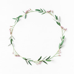 Flowers composition. Wreath made of pink flowers and eucalyptus leaves. Flat lay, top view