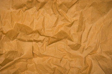 Fototapete - Brown crumpled paper texture background