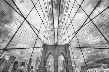 Wide angle black and white picture of Brooklyn Bridge, New York City, USA.