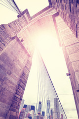 Vintage stylized wide angle picture of Brooklyn Bridge, New York City, USA.
