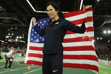 Suhr of the U.S. holds an American flag as she celebrates winning the women's pole vault competition at the IAAF World Indoor Athletics Championships in Portland