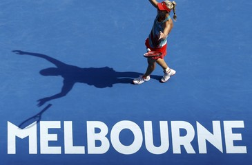 Germany's Kerber casts a shadow as she celebrates after winning her semi-final match against Britain's Konta at the Australian Open tennis tournament at Melbourne Park
