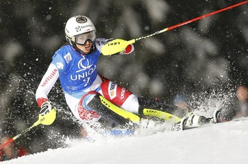 Holdener of Switzerland clears a pole in the women's night slalom race of the Alpine Skiing World Cup in Flachau