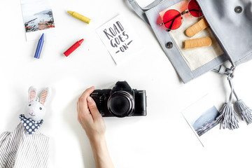 children tourism outfit with toys and camera on white background flat lay