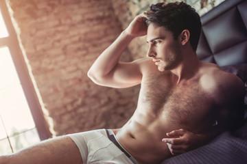 Handsome man on bed