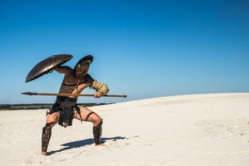 Spartan warrior goes under the shield