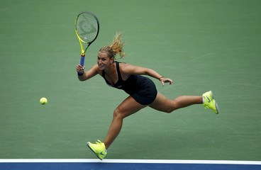 Cibulkova of Slovakia returns to Ivanovic of Serbia during their match at the U.S. Open Championships tennis tournament in New York