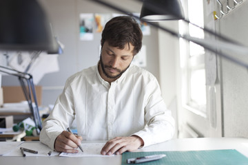 Architect student sketching