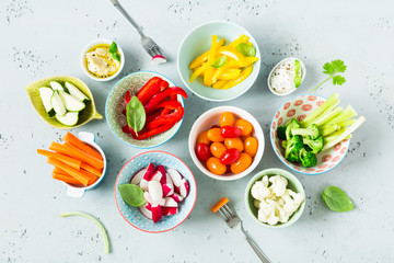 Vegetarian snacks - colorful vegetables and dips in bowls