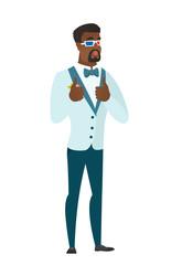 African groom watching movie in 3D glasses.
