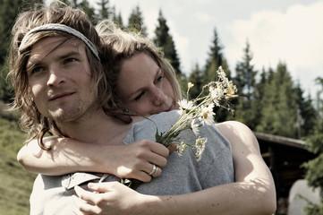Couple hugging in rural meadow