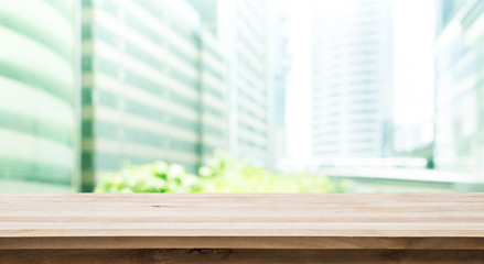 Wood table top with building office view background
